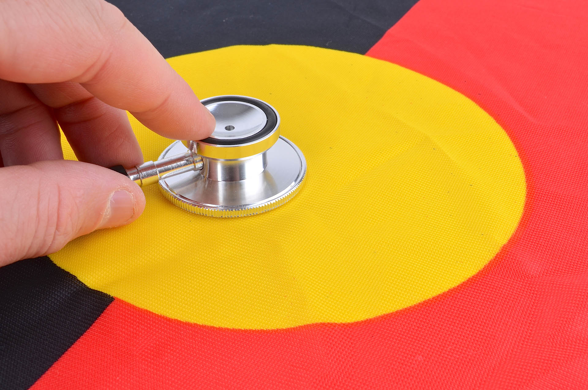 Stethoscope placed on Indigenous flag